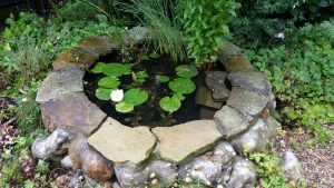 A courtyard flint and Yorkstone  pool